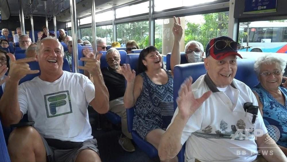 カンボジア政府によるウエステルダム号乗客のバスツアー接待